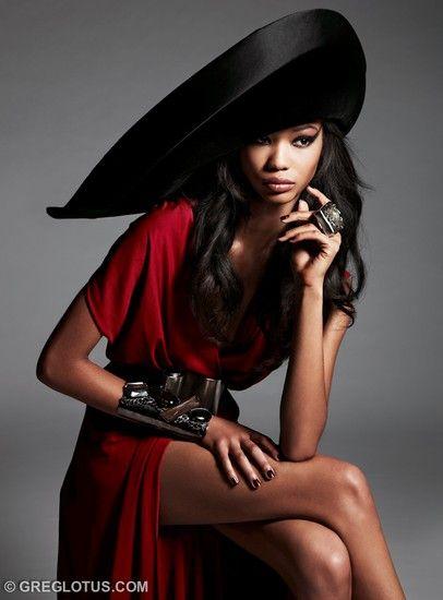 Greg Lotus, Model: Chanel Iman in her sleek red dress and black hat.