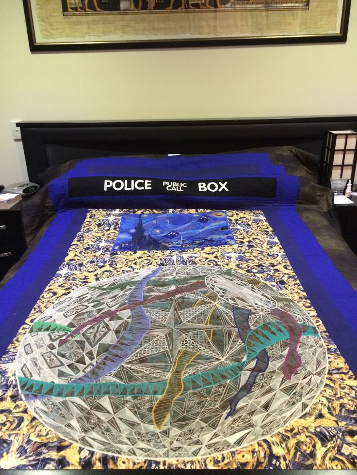 Tardis embroidered quilt. Centre panel is from Hoop Sisters withe Starry Night and Church of Auvers as panels