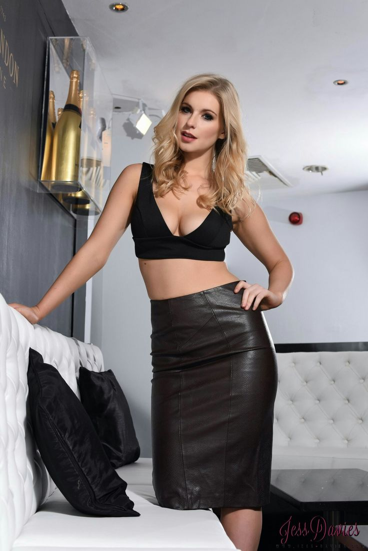 Blonde in high waisted leather pencil skirt