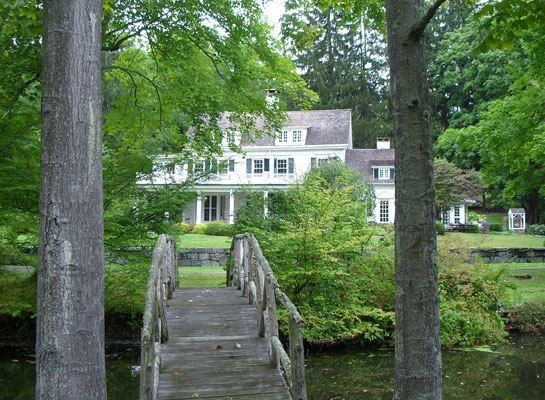 A Bedford, New York, home currently on the market sits on eight wooded acres and includes a guest cottage.