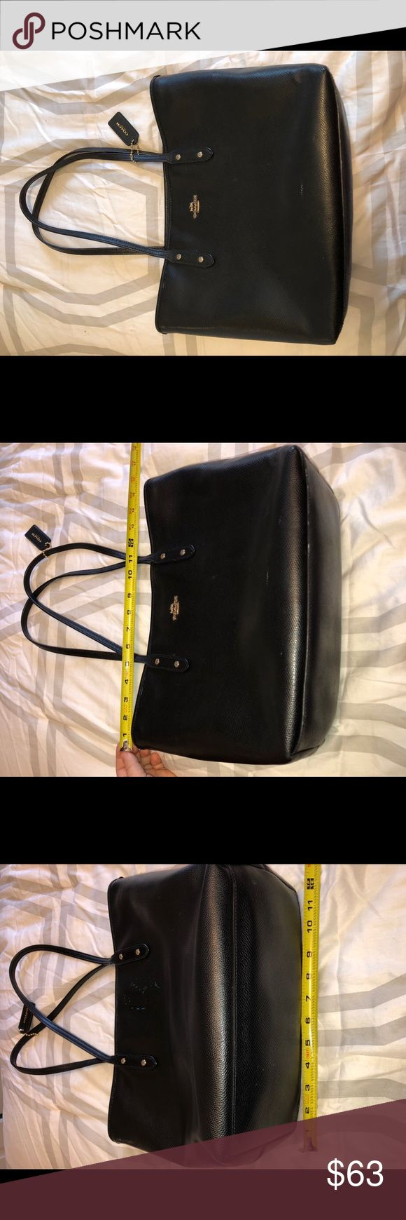 Beautiful black Coach purse This purse is amazing! I have used It a ton, so there is some wear (shown in the pictures). It has a real paint stain on the side ( I'm not sure if It can be removed, I️ haven't tried). The straps also have some wear (shown in the pictures) the purse is still in good condition and still has a lot of life left in It. Make me an offer! :) Coach Bags Shoulder Bags