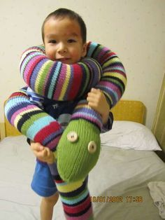 Enormous stripey knitted snake...i have to make this!