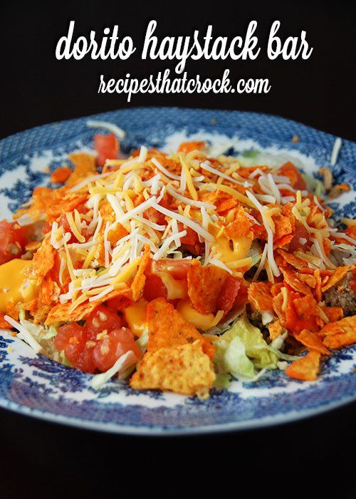 Dorito Haystacks Are A Delicious Spin On A Salad Bar Rice Saltines Cheese Sauce And Ground Beef Along W Beef Recipes Ground Beef Recipes Great Salad Recipes