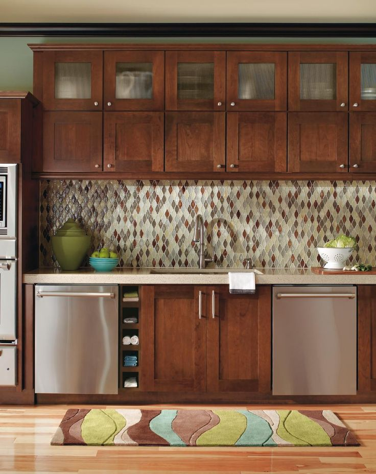 homey in a modern way the warmly lines of these contemporary cherry kitchen cabinets create a setting for a centralized range and hood with personality  34 best timeless classics images on pinterest   kitchen cabinets      rh   pinterest com