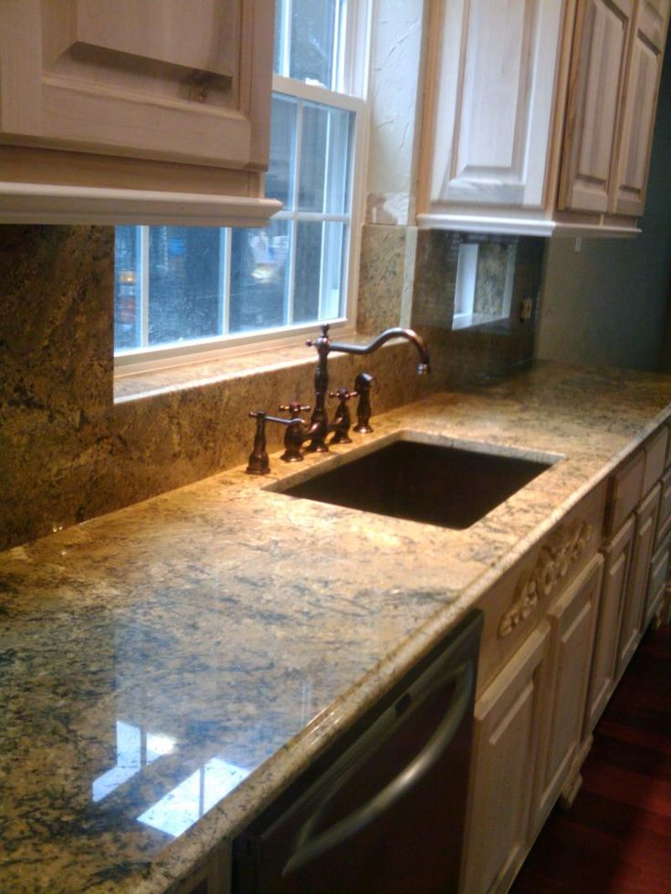 Santa Cecelia Granite Copper Sink Antique White Cabinets