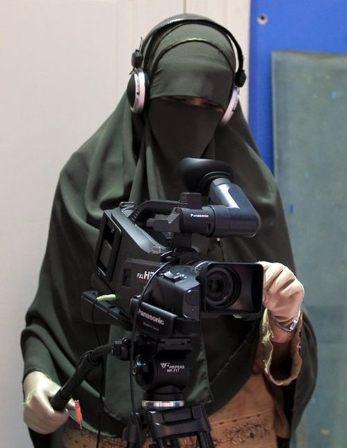 A video woman records a program in a studio of a new TV channel which is being managed and run exclusively by women who wear the full veil, to be launched this weekend, in Cairo, July 19, 2012. In an age of new freedoms in the post-Hosni Mubarak Egypt, niqab-wearing women long oppressed socially and politically are hoping for a new place in society. Though Egypt is a deeply conservative and predominantly Muslim society, niqab wearers have cited discrimination in the job market, education and…