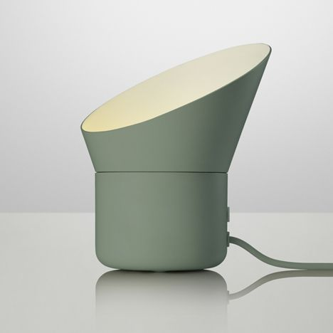 Uplighter for Danish brand Muuto that can be adjusted by rotating the shade.