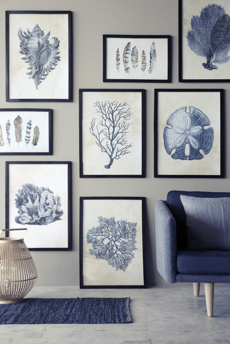 Scandi inspired. A cluster of framed artwork makes a beautiful statement in the living room.