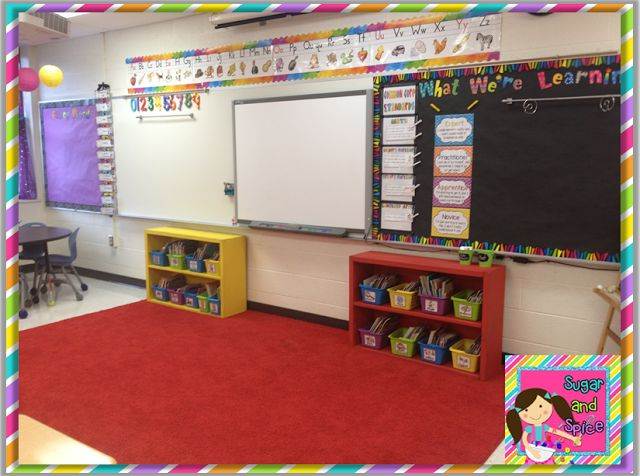 """I really like all of the spaces within this first grade classroom! Particularly, I like this area that takes up a large portion of the classroom. Whole group meeting areas are usually where instruction for the day begins and when students can share their accomplishments. I also love that this classroom displays the standards they are working on and how students can know when they are an """"expert"""" on an objective."""