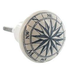 White and blue ceramic round compass knob.