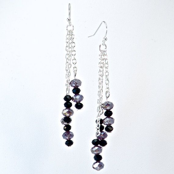 PURPLE & JET PEBBLE EARRINGS  Beautiful genuine Rondelle Swarovski Crystals in tones of Iridescent Purple Velvet and Jet Black layered with Sterling Silver Rolo Chain with a Sterling Silver earring hook. These earrings are inspired by stacked stones on the beaches that represent a spirit of Zen.  CA $34.95 http://pursuademe.com/shop/?id=35
