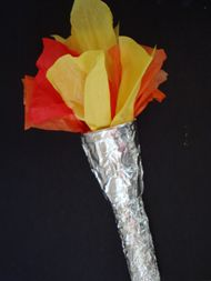 So far this is my favorite Olympic torch craft because it uses entirely materials we already have at home, and the kids love wrapping things in aluminum foil!  From Busy Bee Kids Crafts.