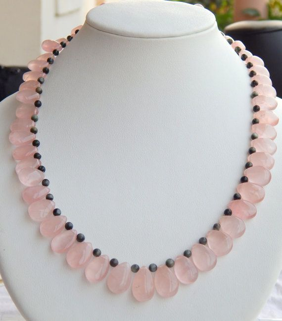 Check out this item in my Etsy shop https://www.etsy.com/uk/listing/489715245/natural-smooth-rose-quartz-and-cats-eye