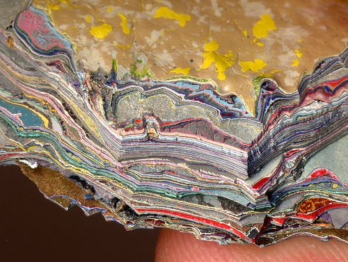 This is a close up of a 1cm thick piece of wall with over 200 layers of paint-for scale you can just see the finger/fingerprint bottom right- WICKED!!!