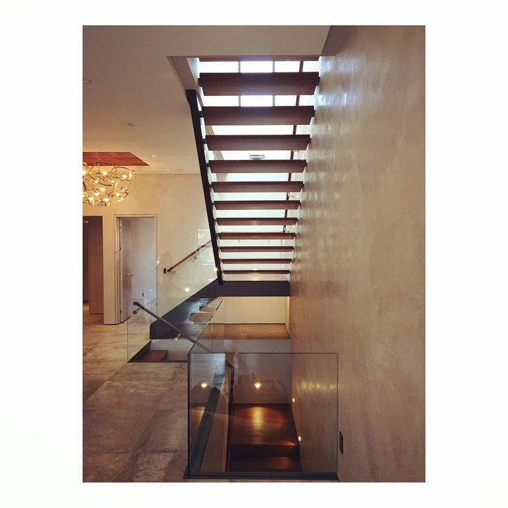 Under the stair. #marlboroughtailor #architecture #stairporn #glass #steel #highend #clean #crisp #minimal #luitron #walnut #concrete #stair #interiordesign #renovation #retrofit #passivehouse #light #venetian #plastered #entry #finehomebuilding #craft #designbuild #backbay #boston #bostondesign