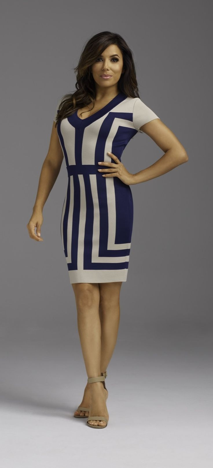 In Power Knit, this luxuriously rich fabric contours your curves for a flawless fit, and a look they'll never forget. With glamorous color blocked detail, this dress exclusively from the Eva Longoria collection is the ideal desk-to-dinner outfit.