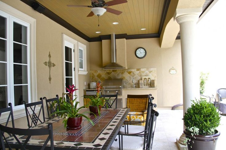 mediterranean summer kitchen with mexico tiles in dining table, brown tiles in counter and top, brown earthy walls  of Welcoming Summer with Cooking Al Fresco