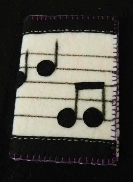 Musical Notes felt notebook cover... wouldn't a music lover or musician love this?