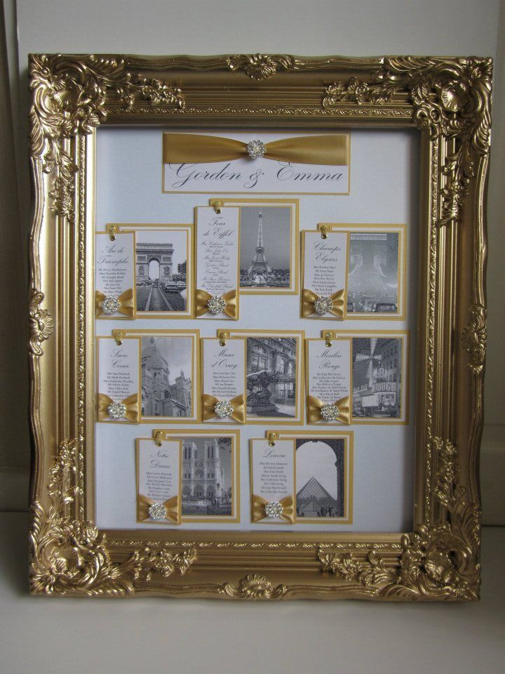White gold Paris theme table plan with black and white pictures of landmarks