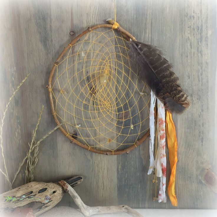This goldenrod yellow dream catcher is intricately hand woven with hand spun raw silk fiber into a natural willow branch, adorned with citrine gemstone nuggets, prayer ties, and feather. Inspiration for these handmade dreamcatchers comes from spirit, Earth Mother, and her elements.