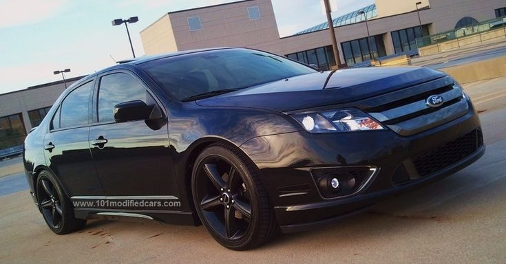 Modified Ford Fusion Sport AWD 3.5 liter V6 (Americas, 1st generation) Black color with front lip, 6000K HID bulb, Steeda Autosports lowering spring (lower by 1.4 inch), tinted windows, Mustang GT Premium Black finish with polished lip 19inch wheels