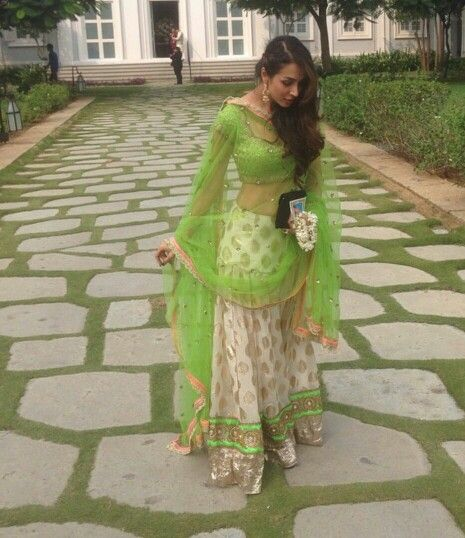 Malaika Arora Khan in Seema Khan lime green and beige lehenga at Arpita Khans wedding 2014 via Instagram #wedding #Indian #beautiful