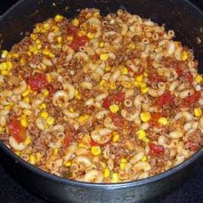 ½C uncooked elbow macaroni 1½lb ground beef 1t  garlic powder 1-8oz can tomato sauce 1c stewed  diced tomatoe 1-15oz corn drain salt & pepper chopped onion Cook pasta, drain Saute ground beef  5 min Add the onion-saute Season w garlic powder salt/pepper Add tomato sauce stewed or diced tomatoes corn& cooked macaroni Stir Heat through5- 7 min  Added alot of sarachi chili for spice