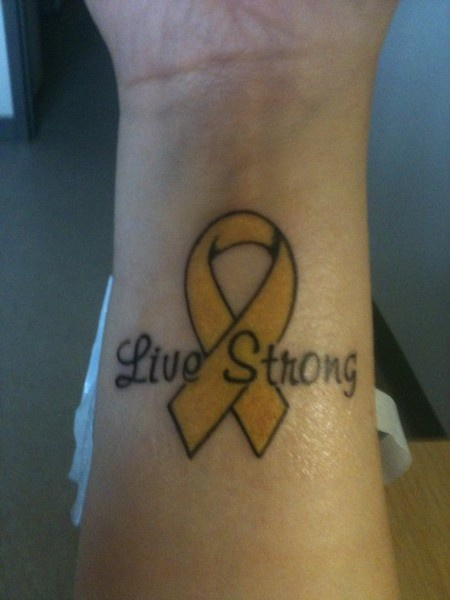 My second tattoo. For my niece, Savannah, who was diagnosed with Retinoblastoma on 06/05/09. It's supposed to be gold for Childhood Cancer Awareness, but it turned out more yellowish because of my skin tone. Font is Murray Hill. Inside of my right wrist. June 2010. http://bit.ly/HKUuFy #LIVESTRONG