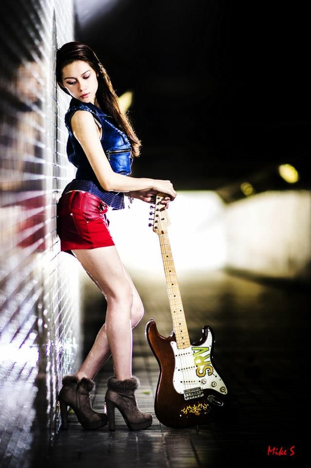 Sapphire Ng, guitarist, model, dancer. Tunnel photoshoot, featuring Stevie Ray Vaughan SRV Lenny guitar, vintage tribute guitar to SRV. Sexy  outfit, red hot skorts and jeans top with brown boots. Cool lighting, photo by Mike S Photography.