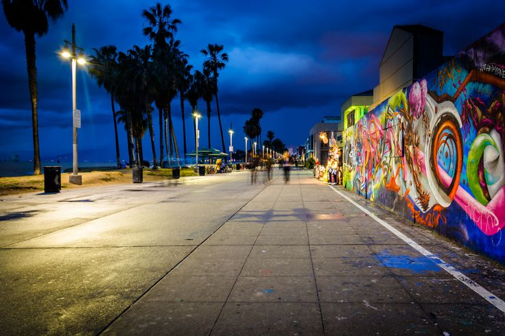 'PROMENADE' - Graffiti along the Venice Beach Boardwalk at night, in Venice Beach, Los Angeles, California.