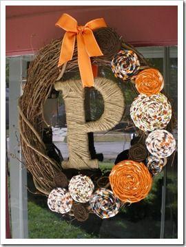 DIY Fall Wreath (store wreath, ribbon, fabric scraps, flowers, letter, yarn)