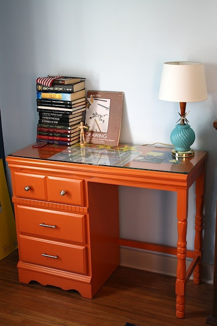 An old 60s-70s era Sears and Roebuck child's study desk rehabbed with orange paint. Ariah would loooooove this! Gotta get me one at a garage sale I know I can find one!! ;)
