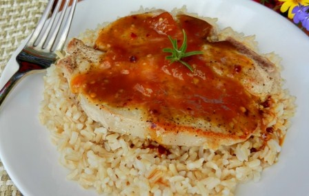 Peach Pork Chops Recipe --Try these Peach Pork Chops with Buttered Brown Rice for an unusual and great combo of flavors for the next time you cook pork chops!