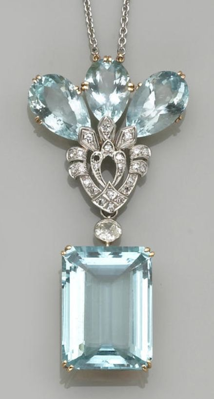 An aquamarine, diamond, platinum and eighteen karat gold necklace the pendant suspending an emerald-cut aquamarine and a European-cut diamond, accented by a central plaque set with pear-shaped aquamarines and single-cut diamonds, completed by a link chain; estimated total aquamarine weight: 76.60 carats; estimated total diamond weight: 1.05 carats; length: 16in.