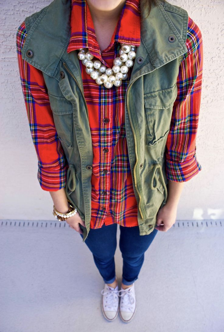 Fall/winter outfit-plaid shirt, cargo vest, jeans, white Converse, and pearl statement necklace.