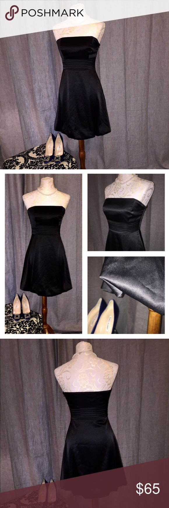 White House Black Market Strapless Dress 💖 Sexy and sophisticated, this dress boasts a delicate poofing at the bottom (see picture) to give it a little extra flirtiness! The top has feather light boning to maintain structure--NO SPENDING ALL NIGHT HIKING THE TOP UP!!! 😄 I know you understand what I mean! ☺️ I wish this dress still fit because I would never let it go!! 💖 White House Black Market Dresses Mini