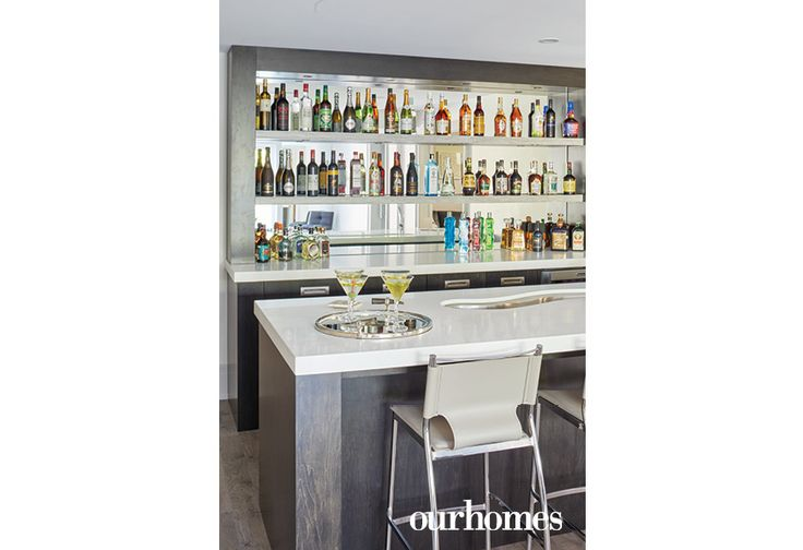 A bar area in the lower level recreation room is centrally located for easy entertaining. See more at http://www.ourhomes.ca/articles/build/article/dedicated-to-details