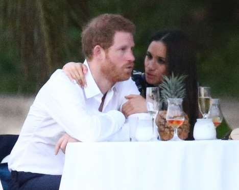 Meghan Markle cozied up to boyfriend Prince Harry during the reception. - SBMF/MiamiPIXX/Fame Flynet