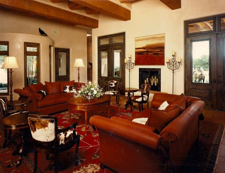 Livingroom with Red Leather Couches and Western Decor