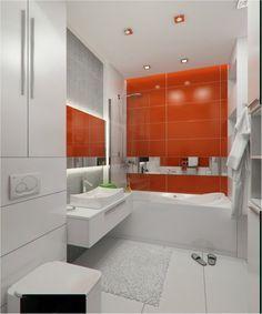 une salle de bains blanche avec un carrelage mural orange