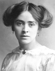 The Side-swirls hairstyle is associated with the smart educated Edwardian woman.   Commonly seen worn with a high necked blouse, giving a clean elegant style.  Worn with a collared blouse and necktie, this was the style adopted by women office workers such as typists and secretaries. Often seen in group photographs of women college students.