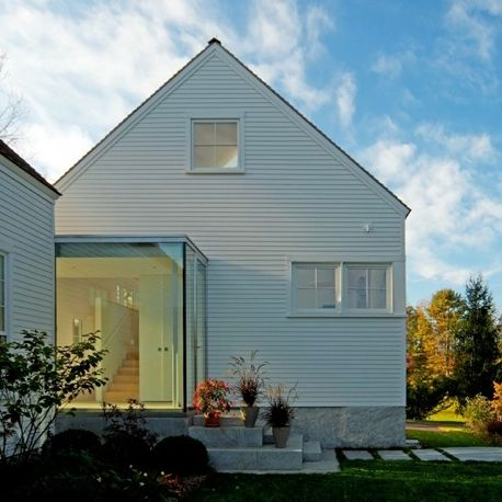 Love rough stone foundation flush with fine clapboard for Transition windows for homes