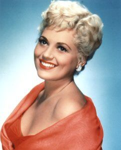 Judy Holliday AKA Judith Tuvim    Born: 21-Jun-1921  Birthplace: New York City  Died: 7-Jun-1965  Location of death: New York City  Cause of death: Cancer - Breast