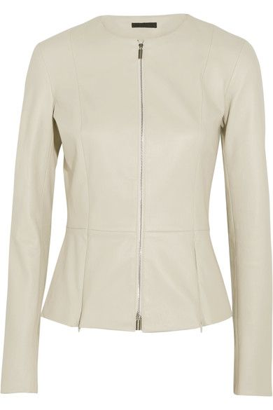 STRUCTURED SILHOUETTE: The Row re-imagines its timeless 'Anasta' jacket in a fresh ecru shade for Spring '17. Crafted from butter-soft leather, it's bonded with comfortable stretch-cotton and finished with concealed zips along the peplum hem - adjust them to create more or less volume.