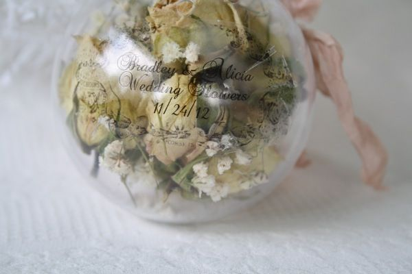Saving wedding flowers in an ornament.  instead of pressed flowers in books... this is another way to save special occasion flowers