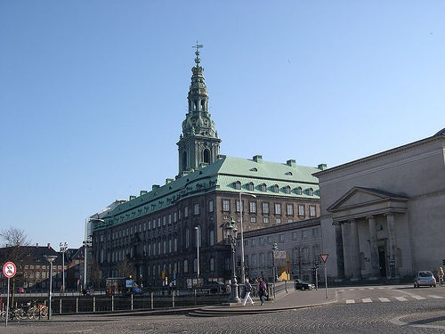 The castle of Christiansborg at Slotsholmen. Two thirds of the castle is the the Danish Parliament and one third belongs to the Danish Queen. She uses it for ceremonial duties and for meeting guests.