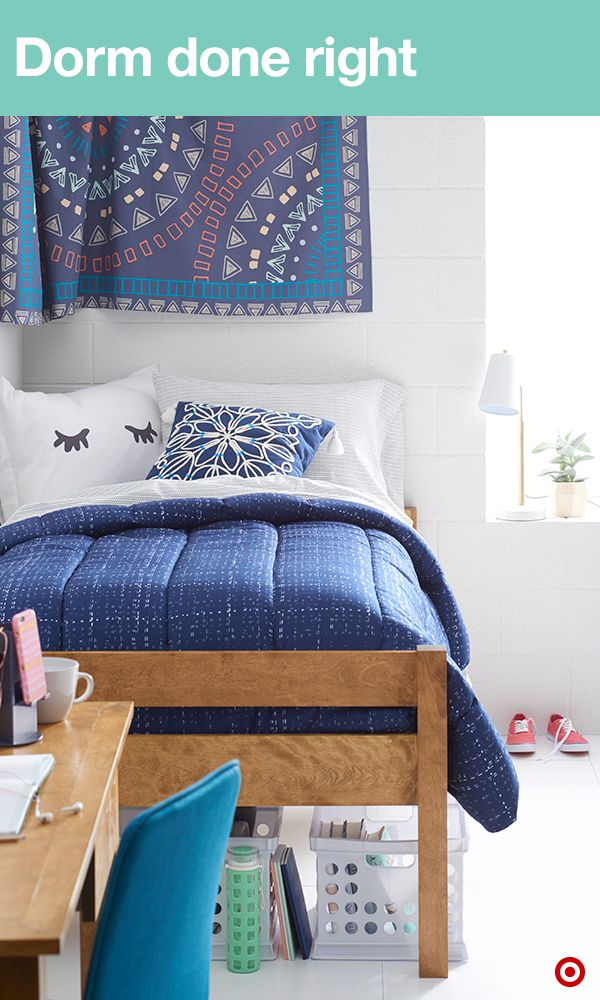 Let's talk about dorm room style. Find a coordinating comforter and sheets in XLT (you'll want these for the extra-long beds). Then add interest to your walls with a tapestry. It will soften and warm up any space. Now you just have to move in and meet the roomie. Then make compact dorm living easy by using of every inch of space. Bins under your bed are the perfect place to organize extra clothes, shoes, school supplies and books.
