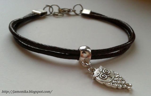 Bransoletka wykonana z brązowego sznurka woskowanego z ozdobną zawieszką sową.