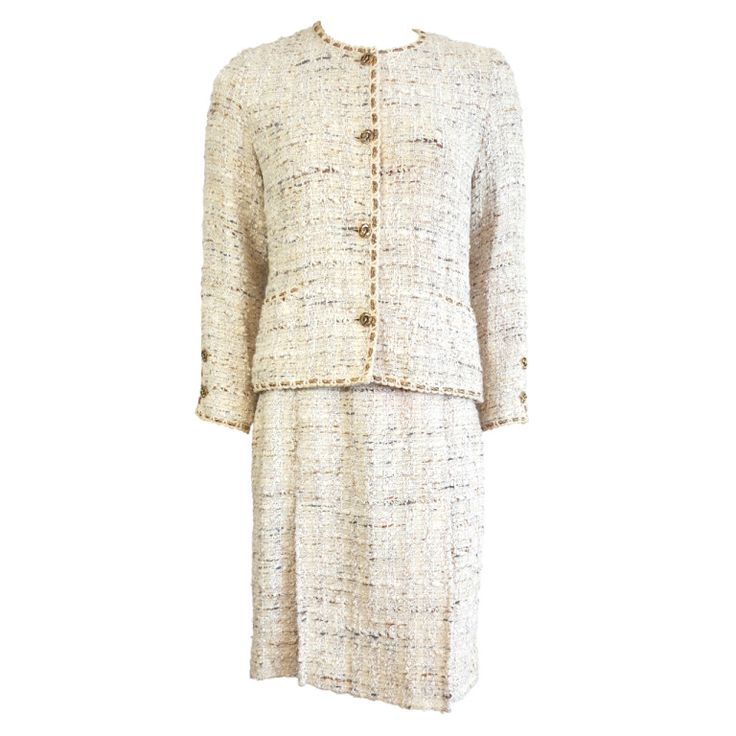 1stdibs.com | Vintage CHANEL Creme bouclé tweed gold bullion skirt suit