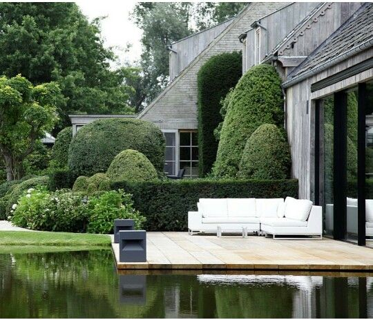 Patios & Decks | Wood deck surrounded by water feature